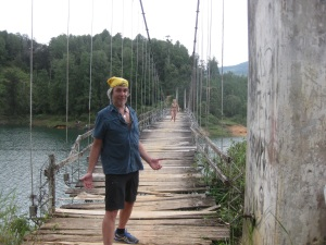 A troubled bridge over water, in Guatapa